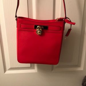 Red Michael Kors crossbody purse